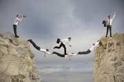 Teamwork and success concept with a bridge of businessperson